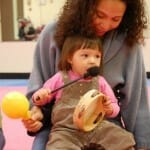 Mother and Toddler playing an Instrument