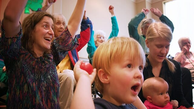 Babies, Toddlers, Adults and Seniors making music and playing together